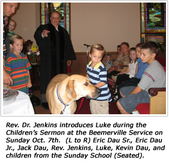 Rev. Dr. Jenkins introduces Luke during the Children's Sermon at the Beemerville Service on Sunday Oct. 7th.  (L to R) Eric Dau Sr., Eric Dau Jr., Jack Dau, Rev. Jenkins, Luke, Kevin Dau, and children from the Sunday School (Seated).